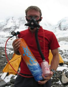 man with face mask and Poisk oxygen bottle