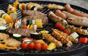 Meat and vegetables on a barbecue